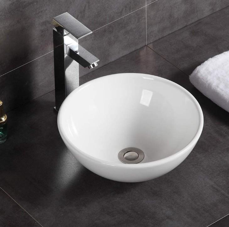 XS 0014lavabo appoggio 1 Lavabo bacinella cod XS-0014 da appoggio in ceramica di forma tonda col bianco lucido