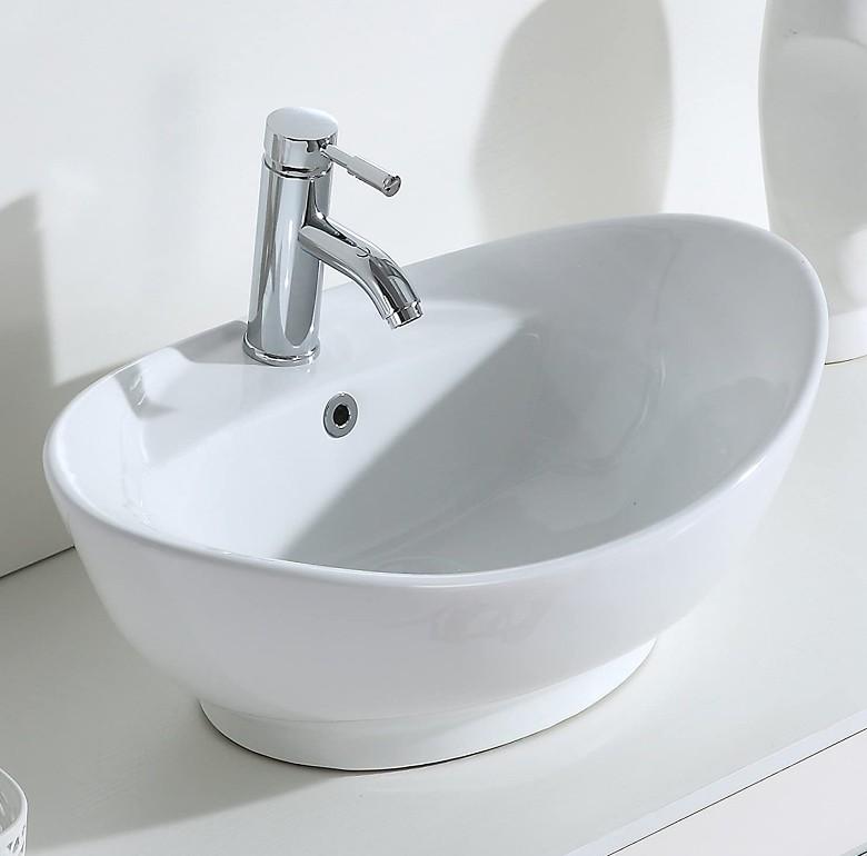 XS 0020lavabo appoggio 1 Lavabo bacinella cod XS-0020 da appoggio in ceramica di forma ovale col bianco lucido