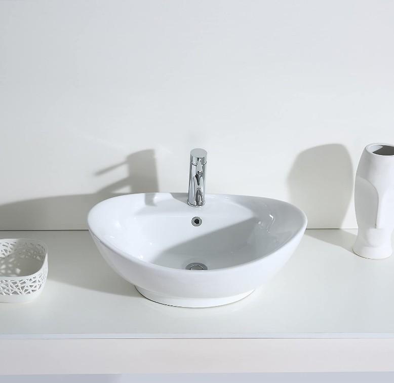 XS 0020lavabo appoggio 2 Lavabo bacinella cod XS-0020 da appoggio in ceramica di forma ovale col bianco lucido