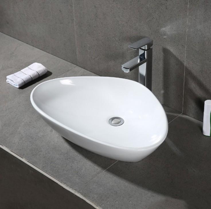 XS 0028lavabo appoggio 1 Lavabo bacinella cod XS-0028 da appoggio in ceramica di forma sfalsata col bianco lucido