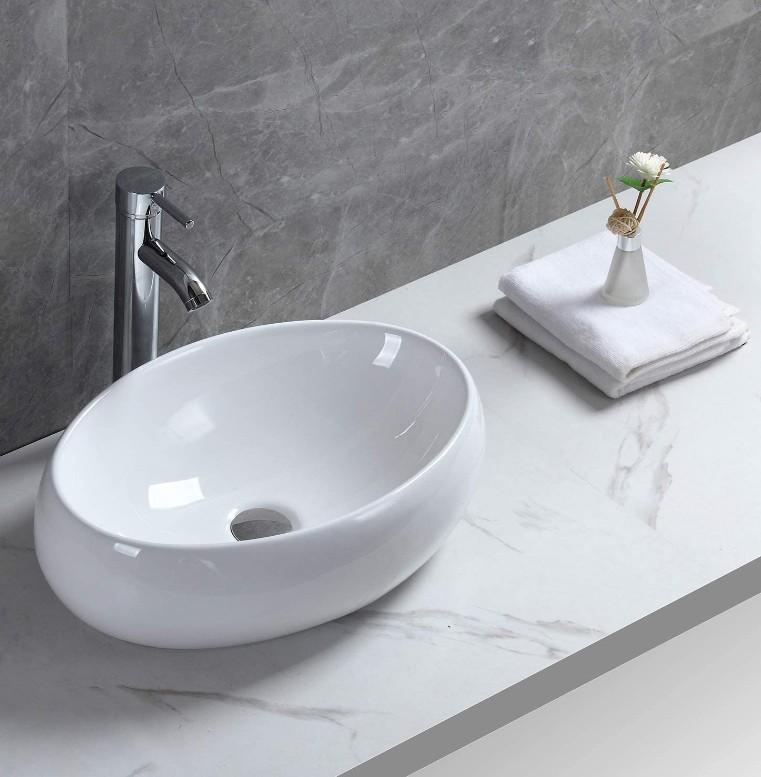 XS 0031lavabo appoggio 1 Lavabo bacinella cod XS-0031 da appoggio in ceramica di forma ovale col bianco lucido