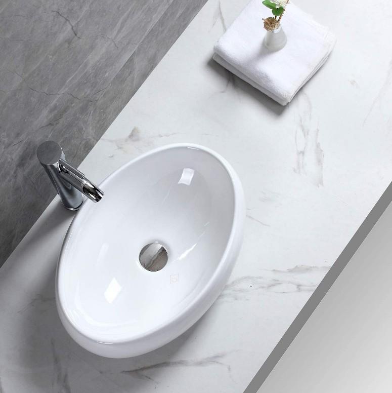 XS 0031lavabo appoggio 2 Lavabo bacinella cod XS-0031 da appoggio in ceramica di forma ovale col bianco lucido
