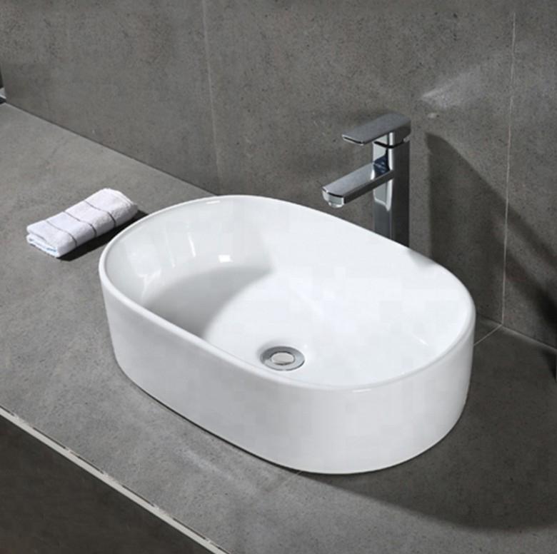 xs 0007lavabo appoggio 1 1 Lavabo bacinella cod XS-0007 da appoggio in ceramica di forma rettangolare col bianco lucido