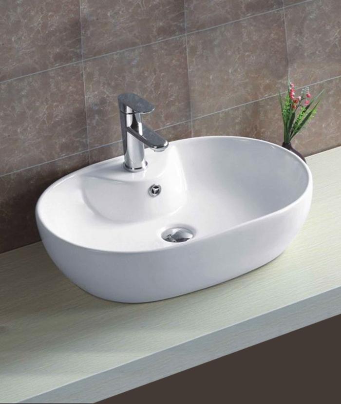 XS 0032Alavabo appoggio Lavabo bacinella cod XS-0032A da appoggio in ceramica di forma ovale col bianco lucido